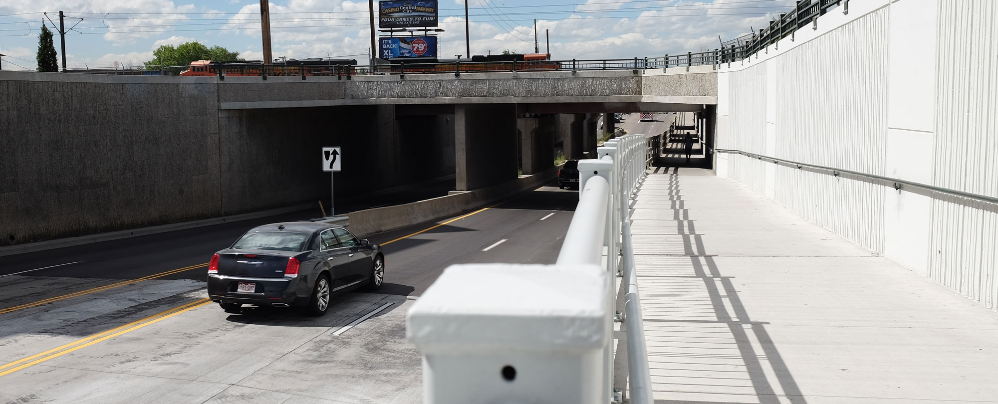 elevated multi-use path next to roadway underpass