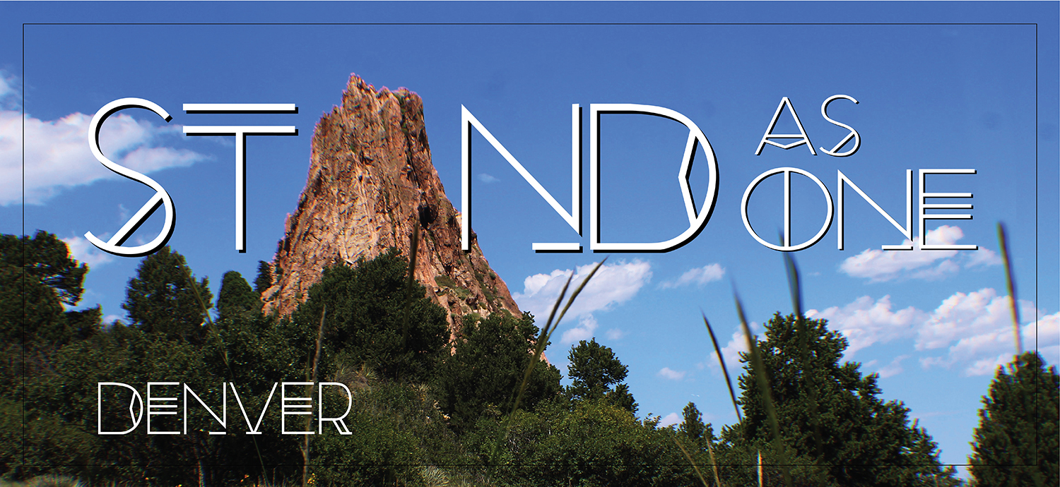 "Rock and trees in background, wording ""Stand as One Denver"" written"