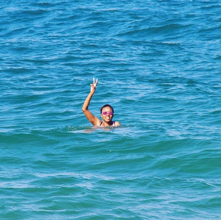 Sweaty person swimming in open water.