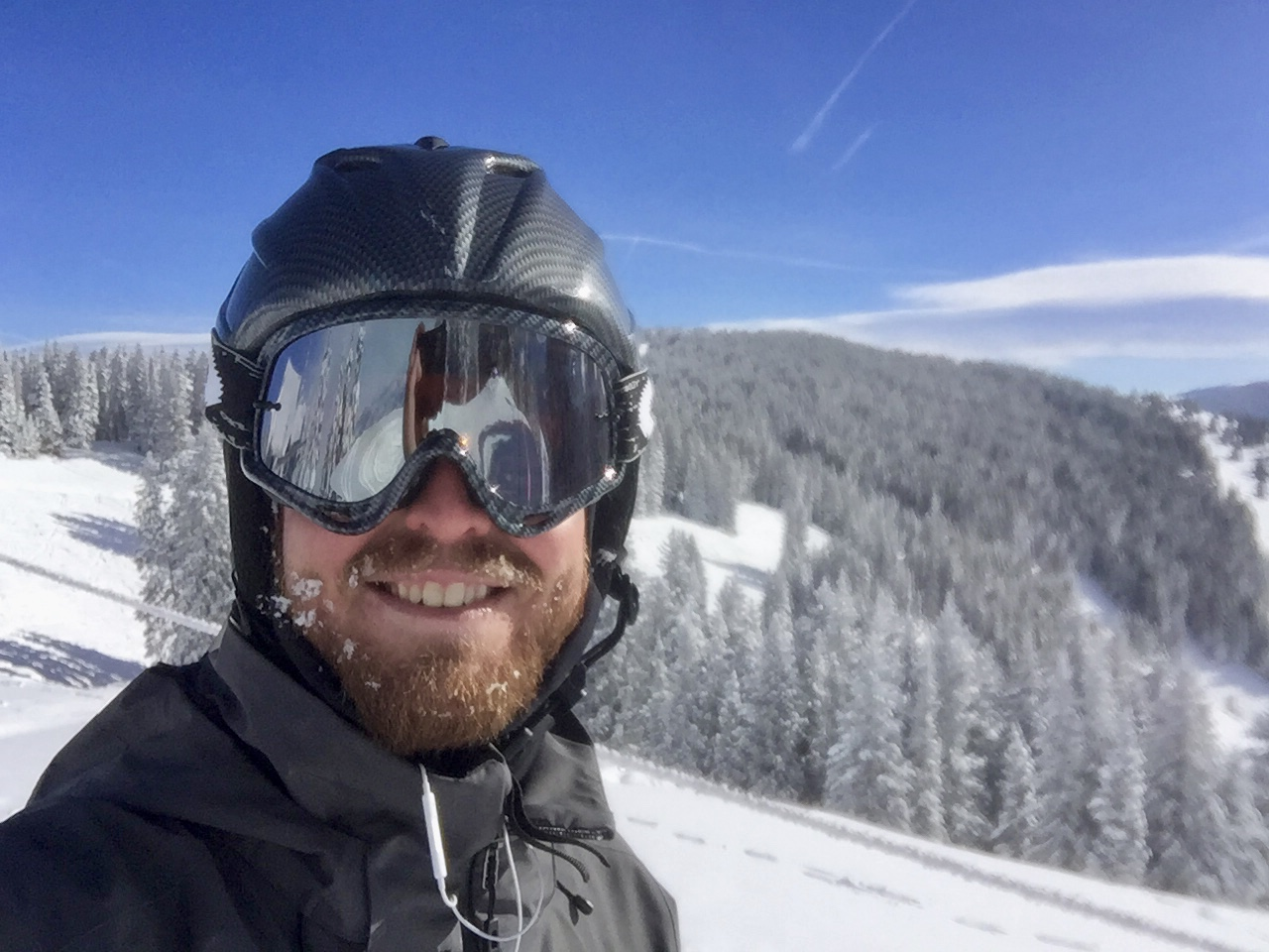 Sweaty person snowboarding