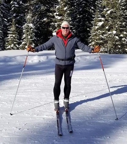 Sweaty person skiing.