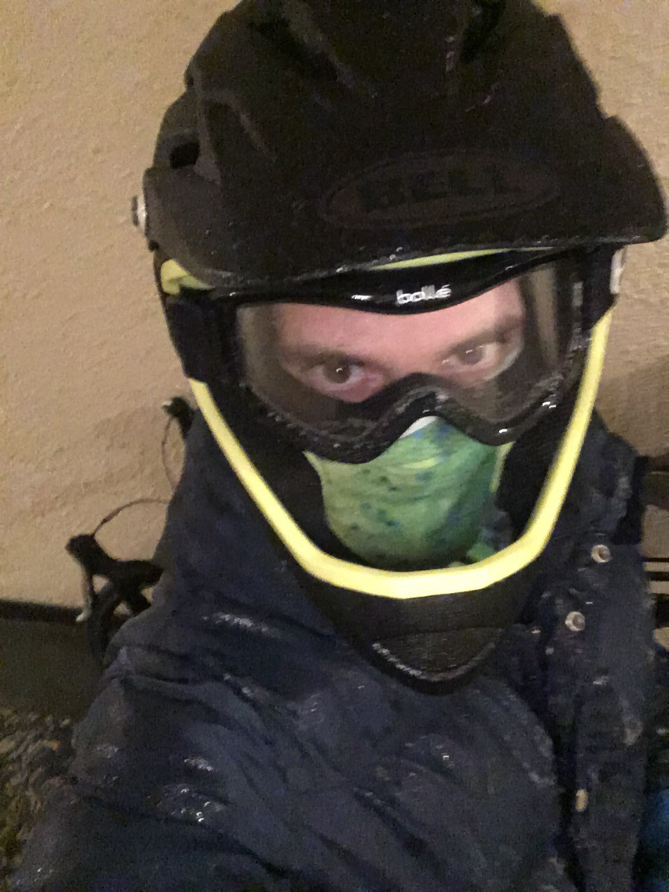 Sweaty person with dirt bike helmet on.