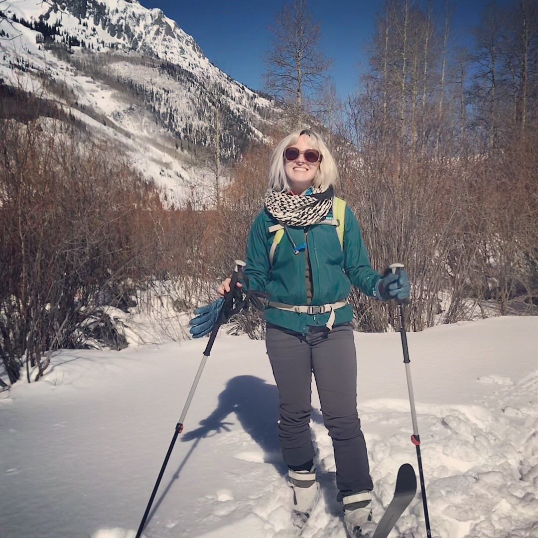 Sweaty person cross country skiing.