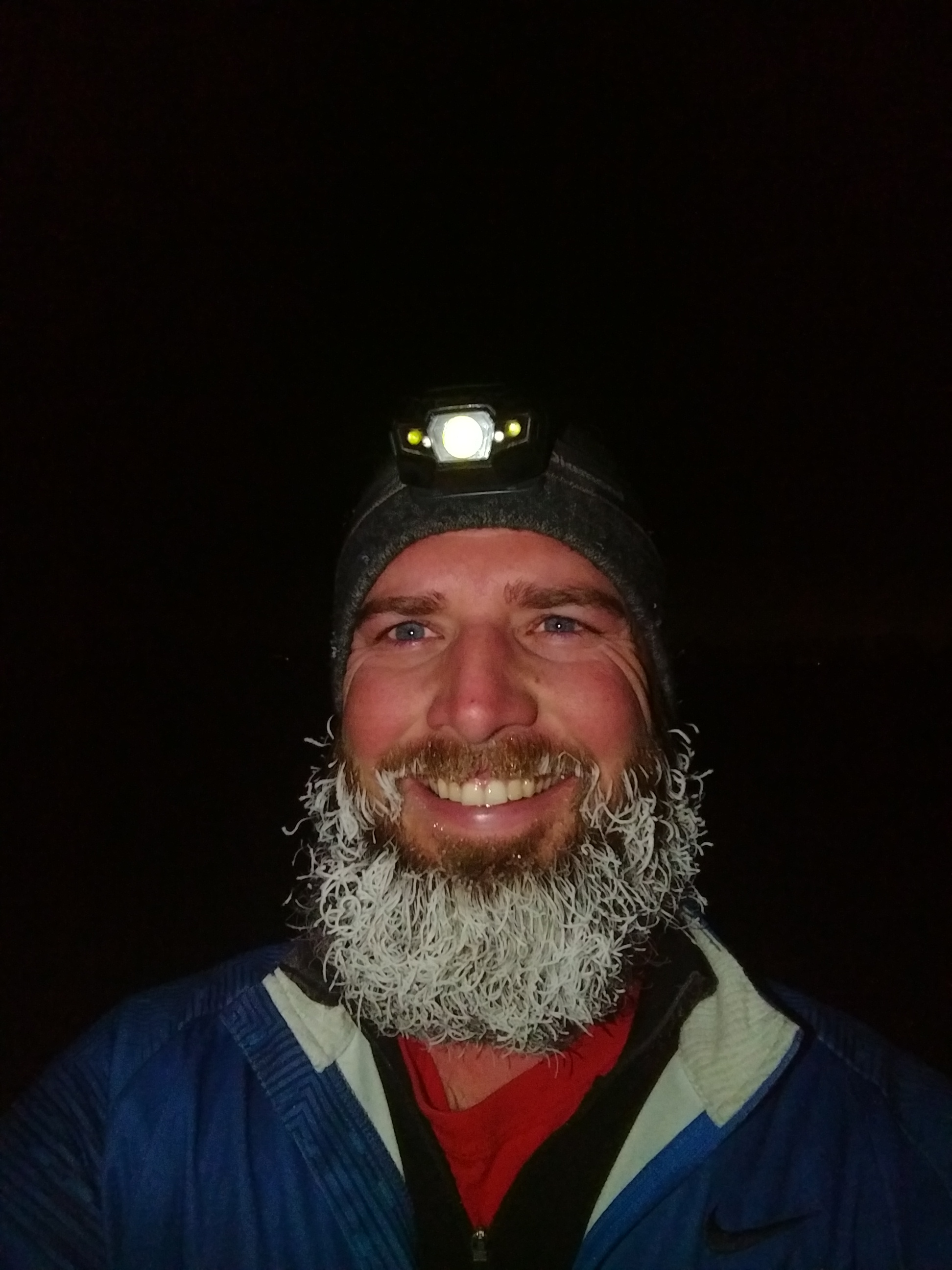 Man with snow frozen in his beard.