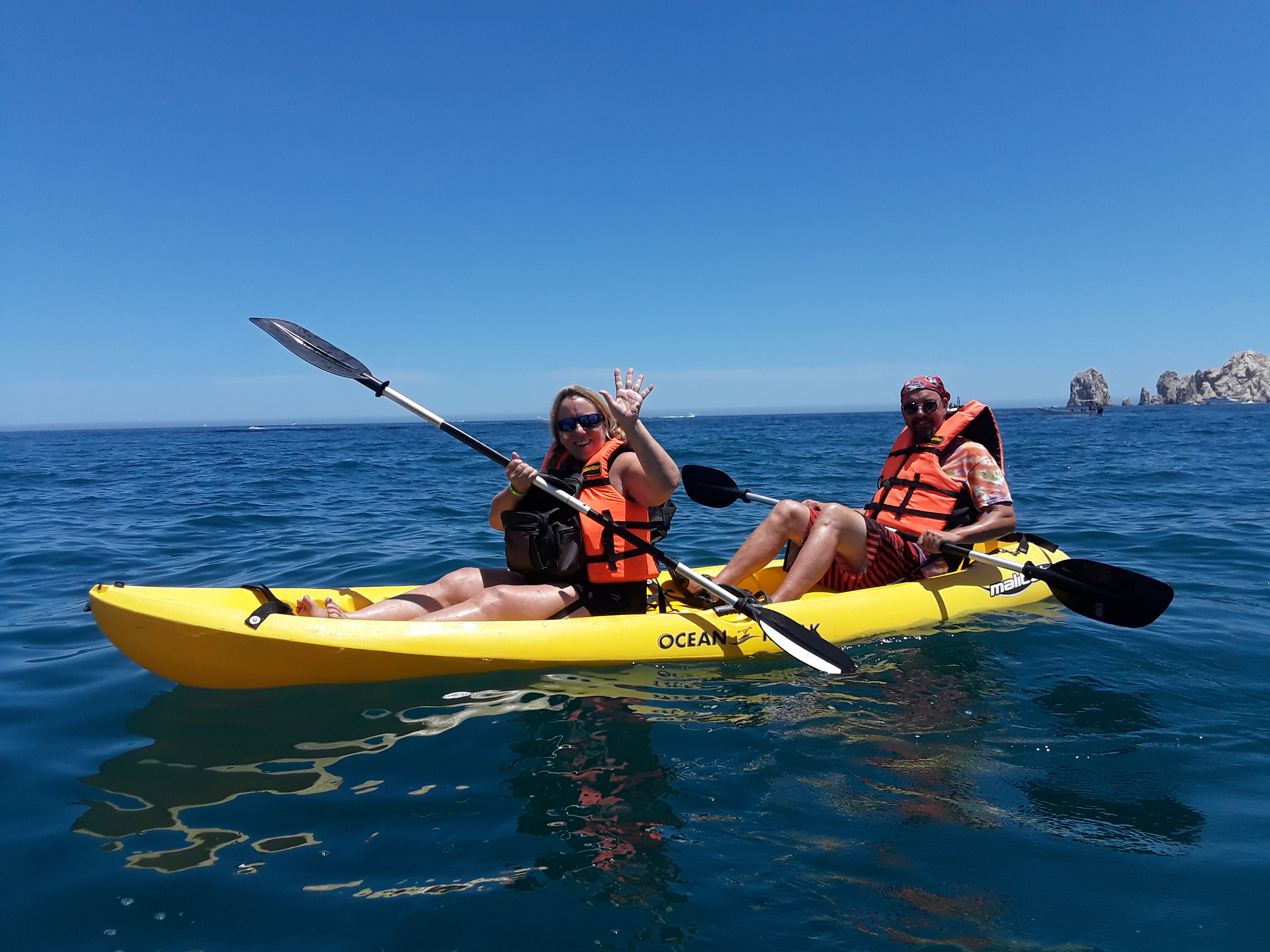 Two sweaty people in a kayak.