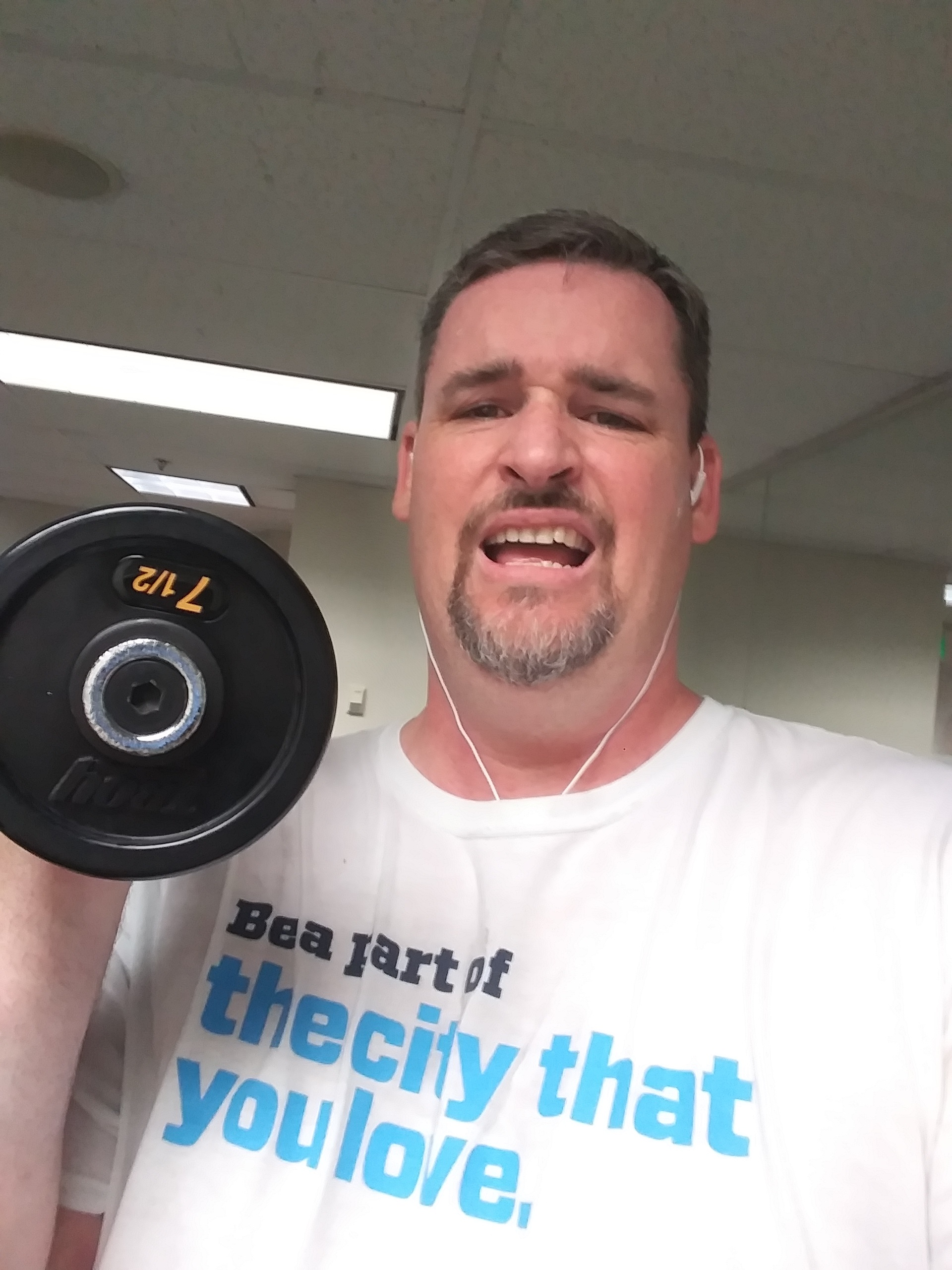 Sweaty person lifting 7.5 lbs weight.