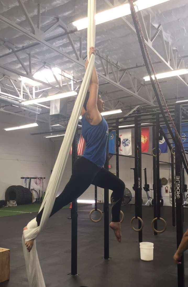 Sweaty person doing aerial aerobics.