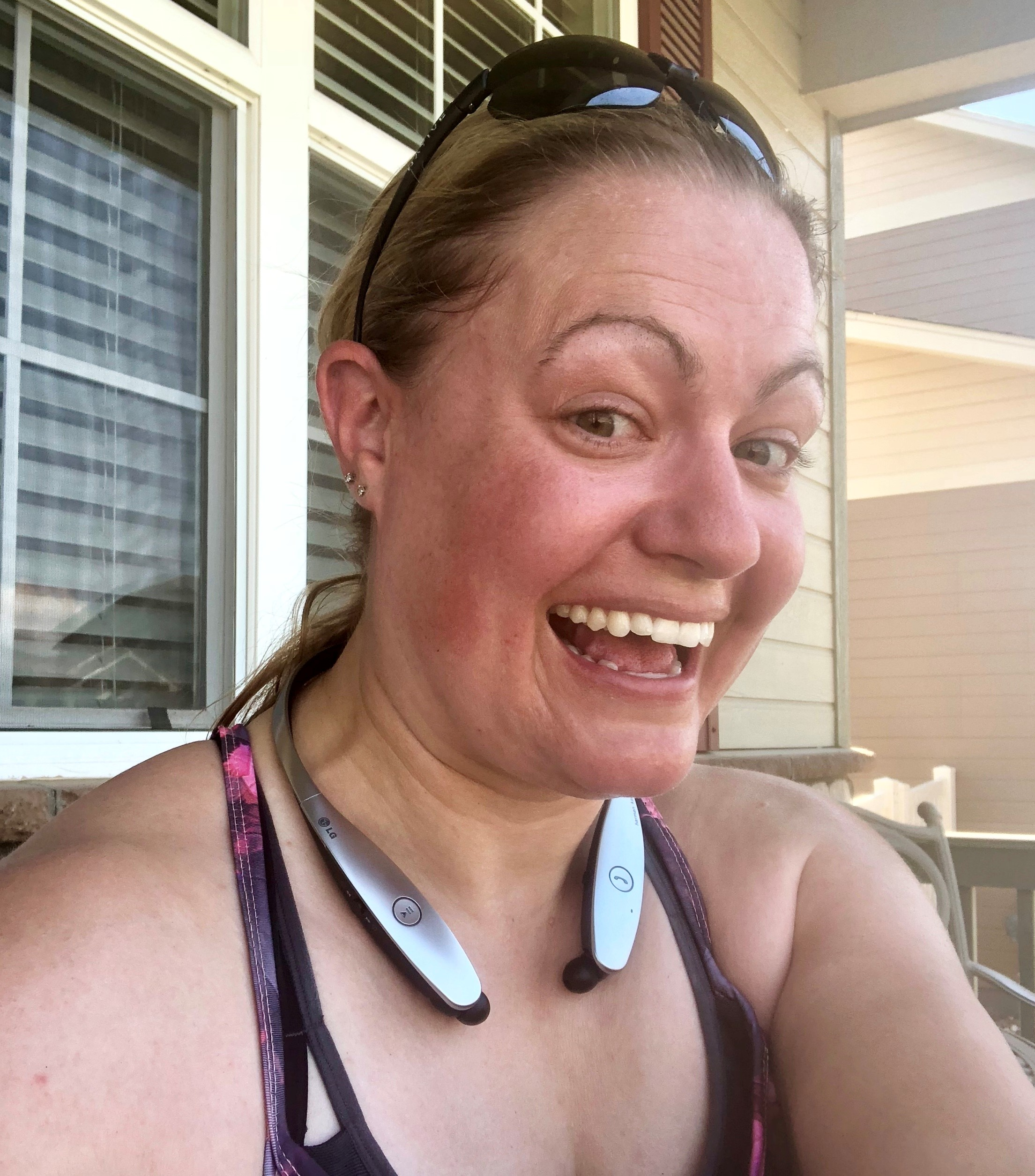 Happy sweaty person after workout on porch.