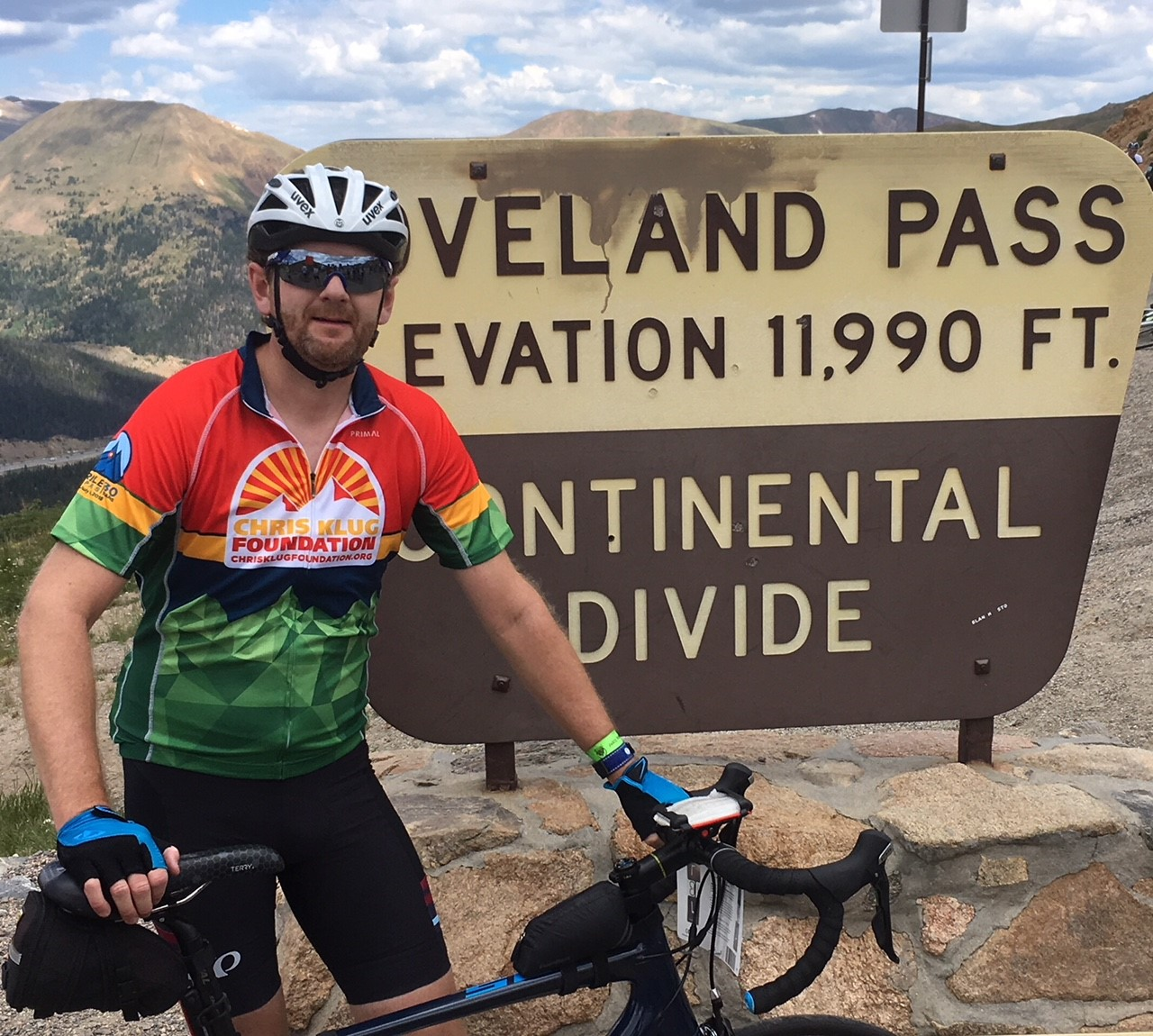 Sweaty person biking on Loveland Pass at the Continental Divide.
