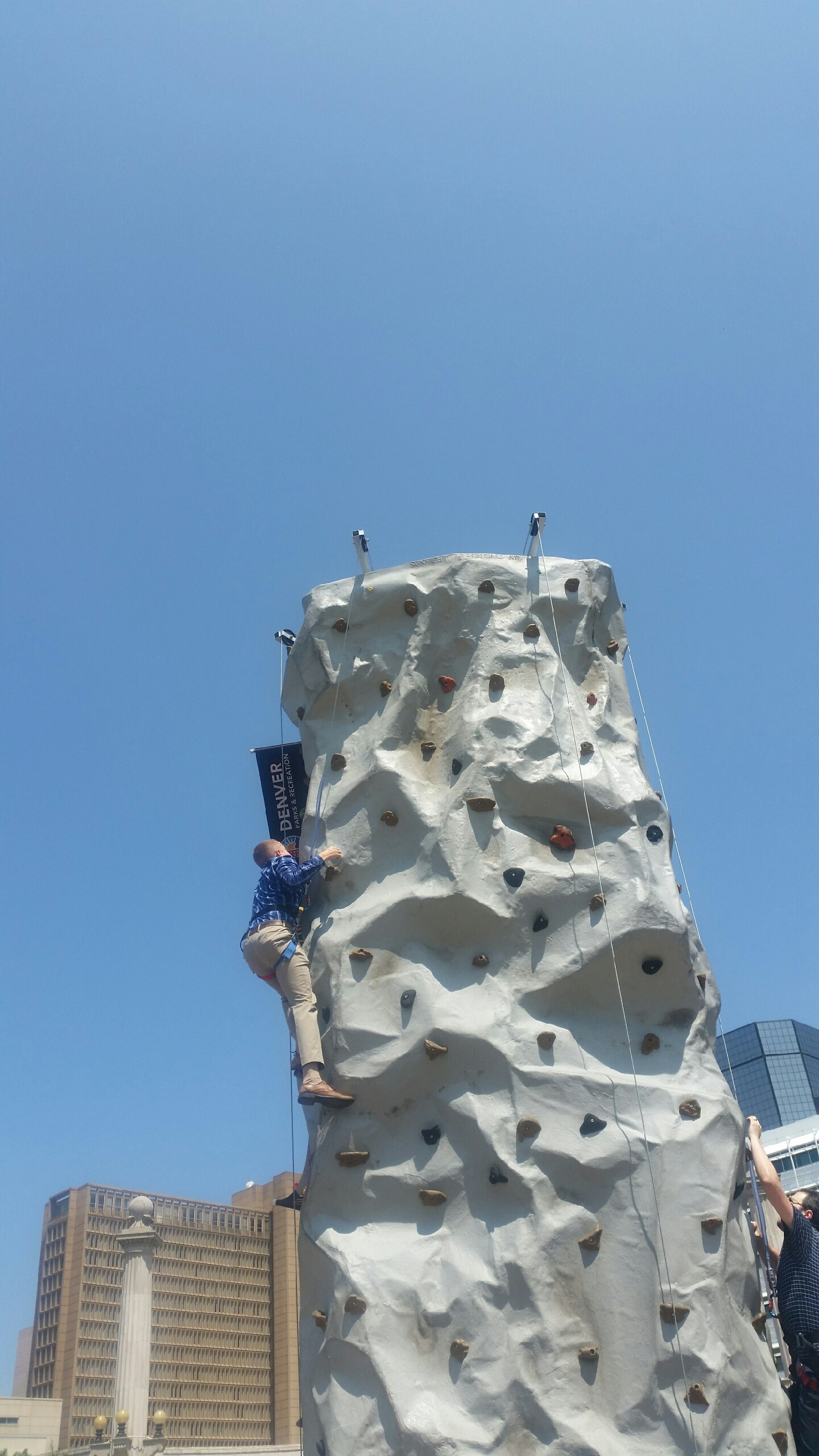 Sweaty person climbing rock wall at Civic Center Park (City Spirit Picnic)