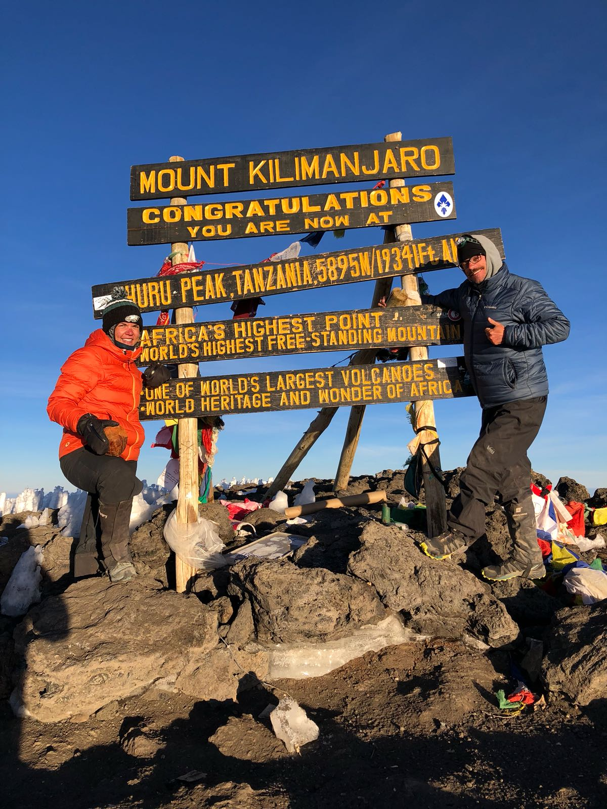 Two sweaty people on top of Mt. Kilimanjaro!