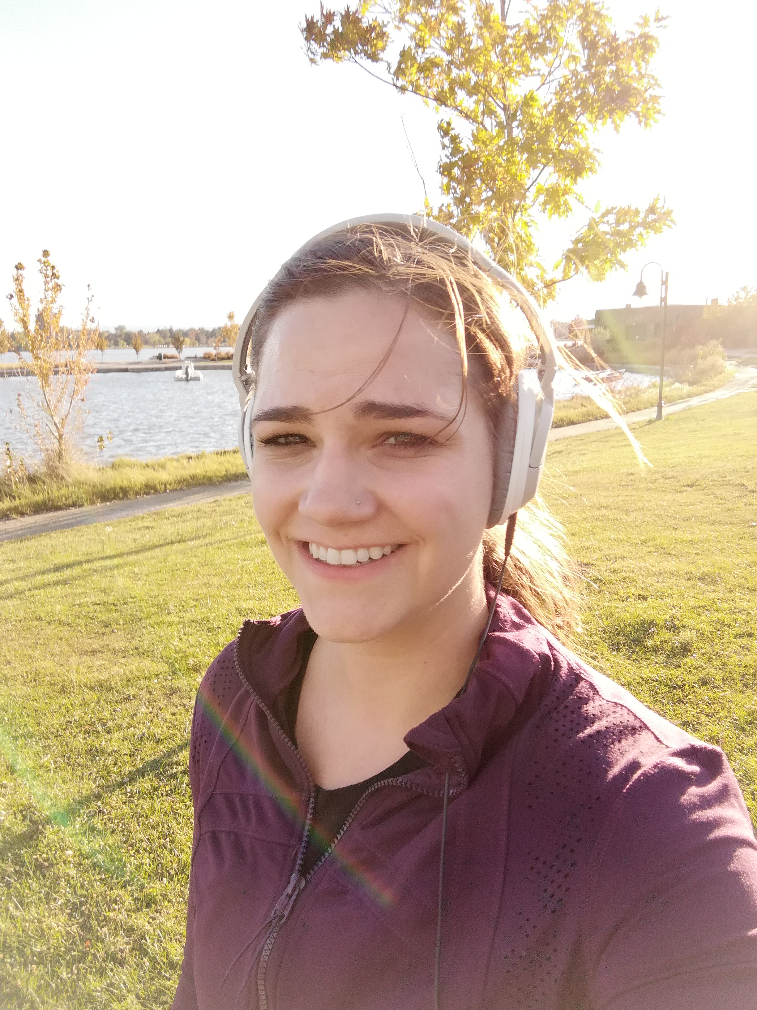 Sweaty person jogging around a lake.