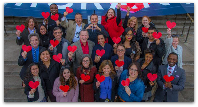 group of employees holding hearts