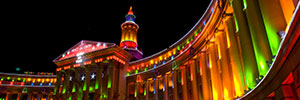 Denver City and County Building lit up with holiday multi-color lights at night