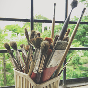 paintbrushes by window