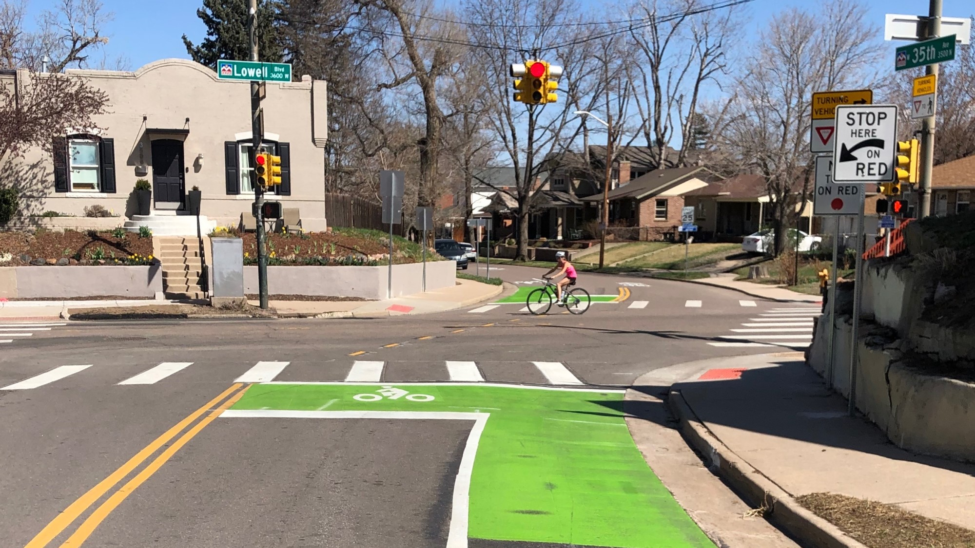 photo of cyclist riding through the intersection of 35th and Lowell in Denver