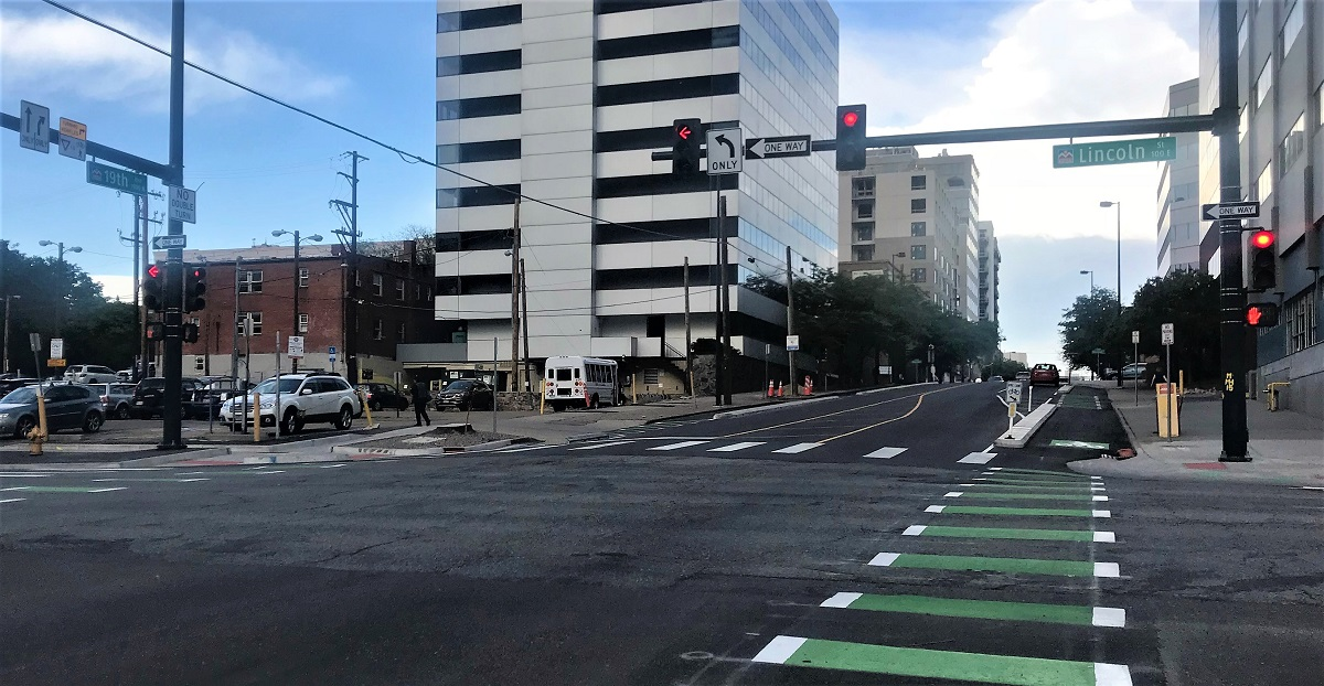striped bike lanes crossing intersection in both directions