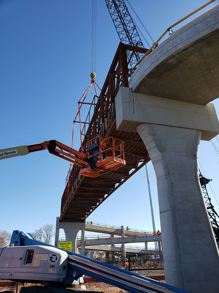 bridge section being lifted for placement