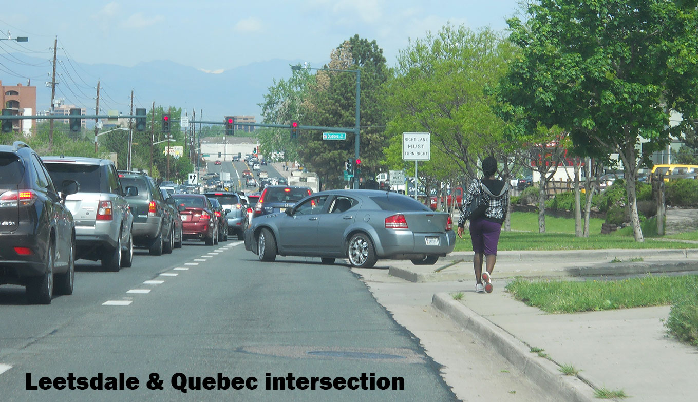 cars in traffic at Leetsdale and Quebec intersection
