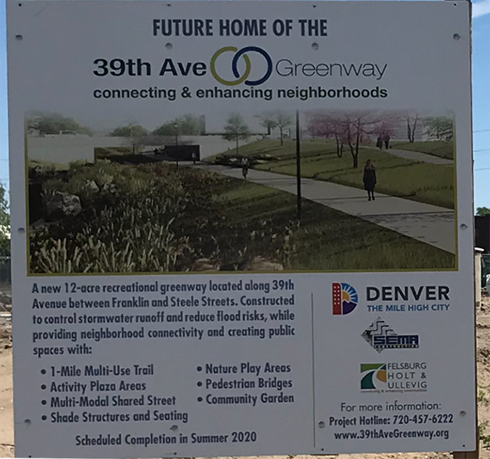 construction area sign with details about future greenway project