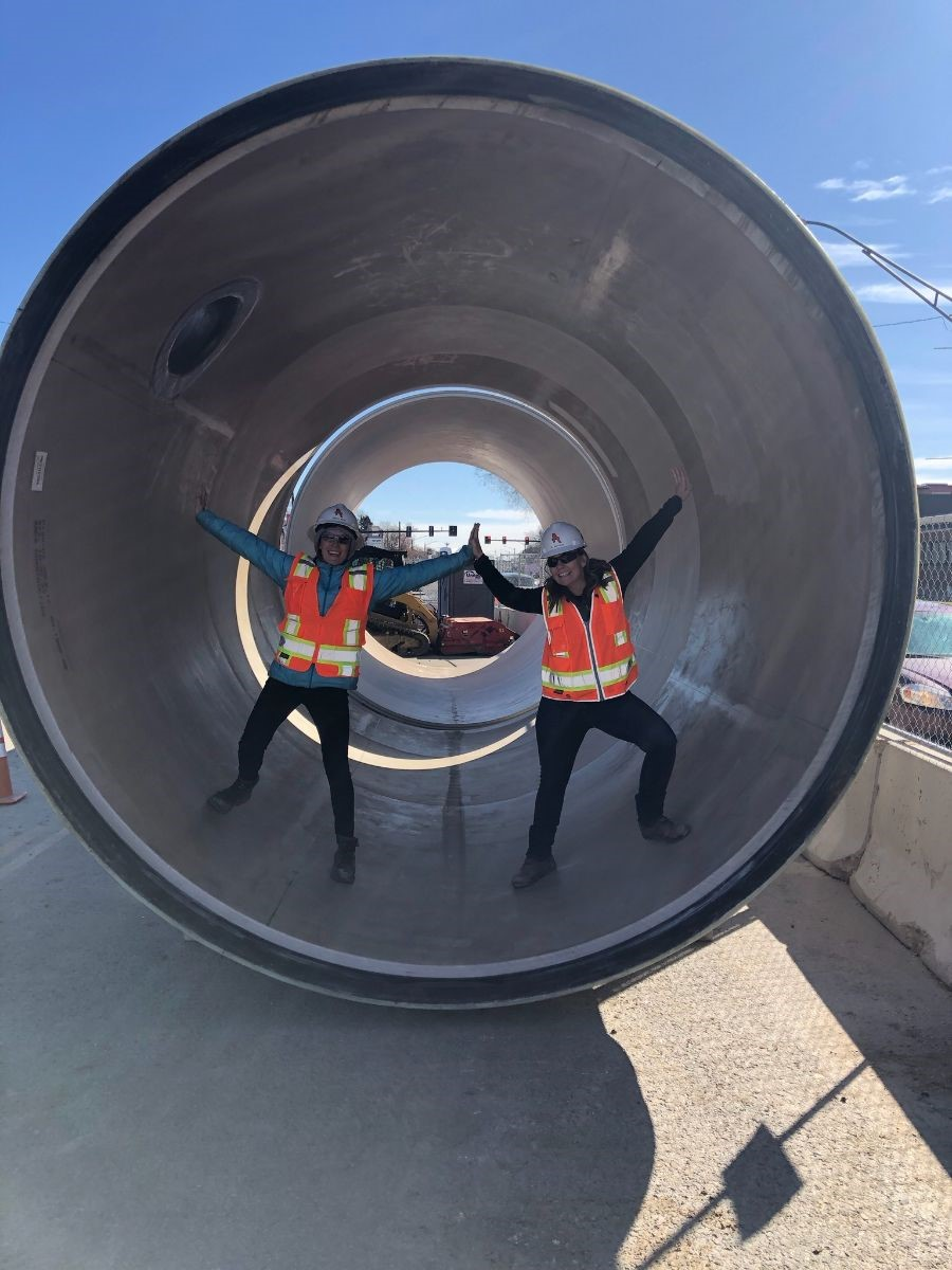 two DOTI employees post standing inside 126-inch stormwater pipe
