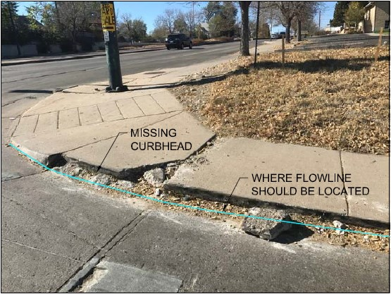 ADA ramp at corner with missing and damaged curb