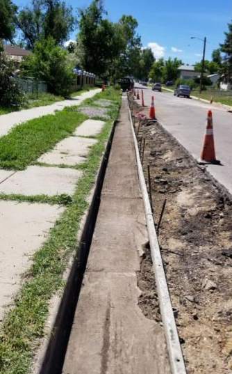 concrete in curb and gutter area removed between sidewalk and street