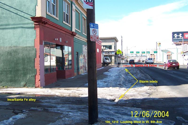 ice on main street near storm sewer inlets