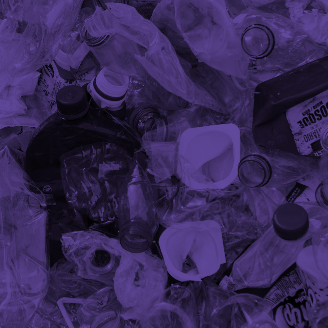 Purple tinted angled top view photo of plastic bottles and bags