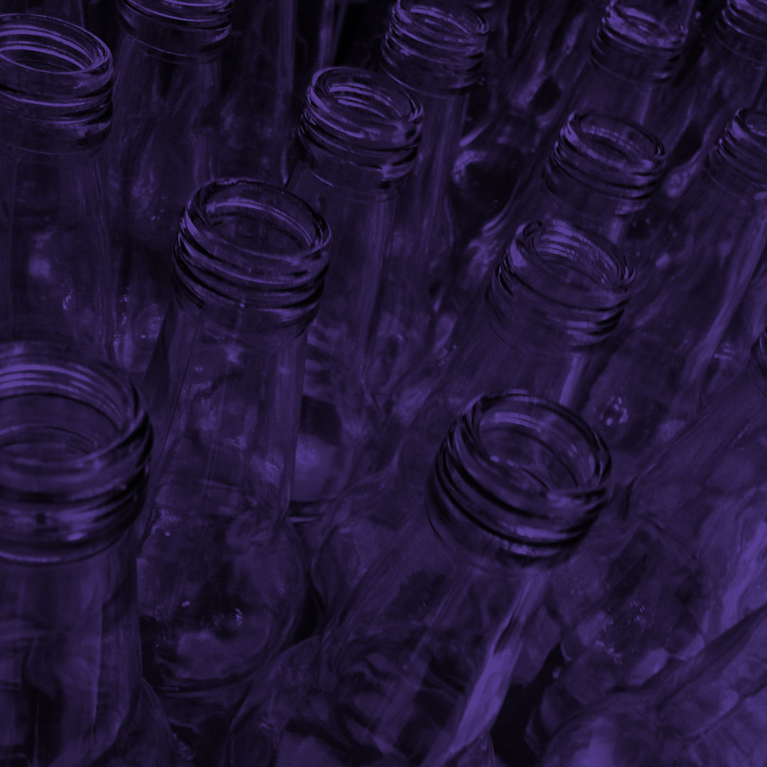 Purple tinted angled top view photo of glass bottles