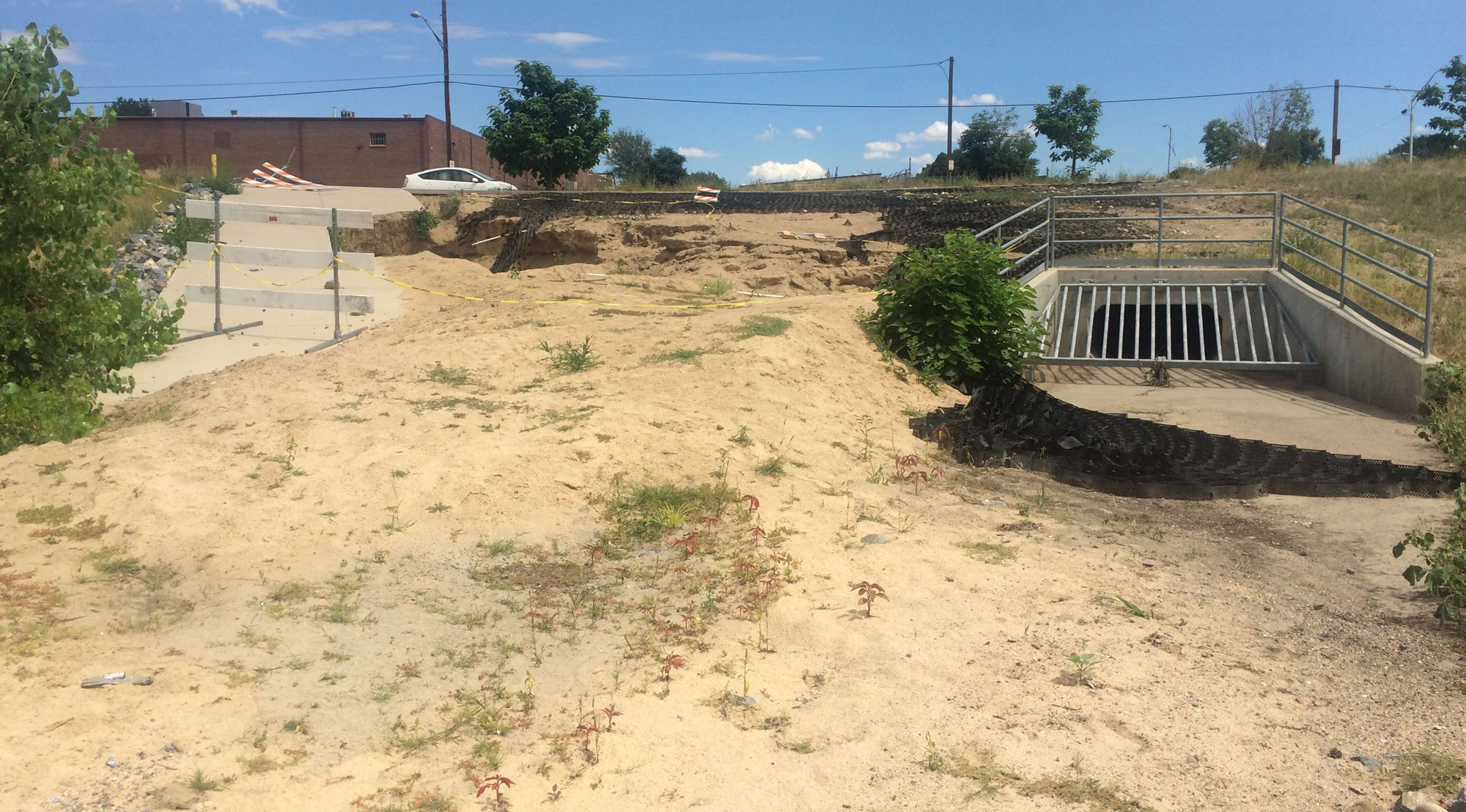 dirt and erosion around detention pond and storm infrastructure