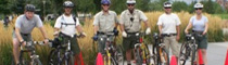 park rangers patrol by bike