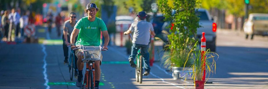 A young man rides his bike on a pop-up dedicated bike lane.