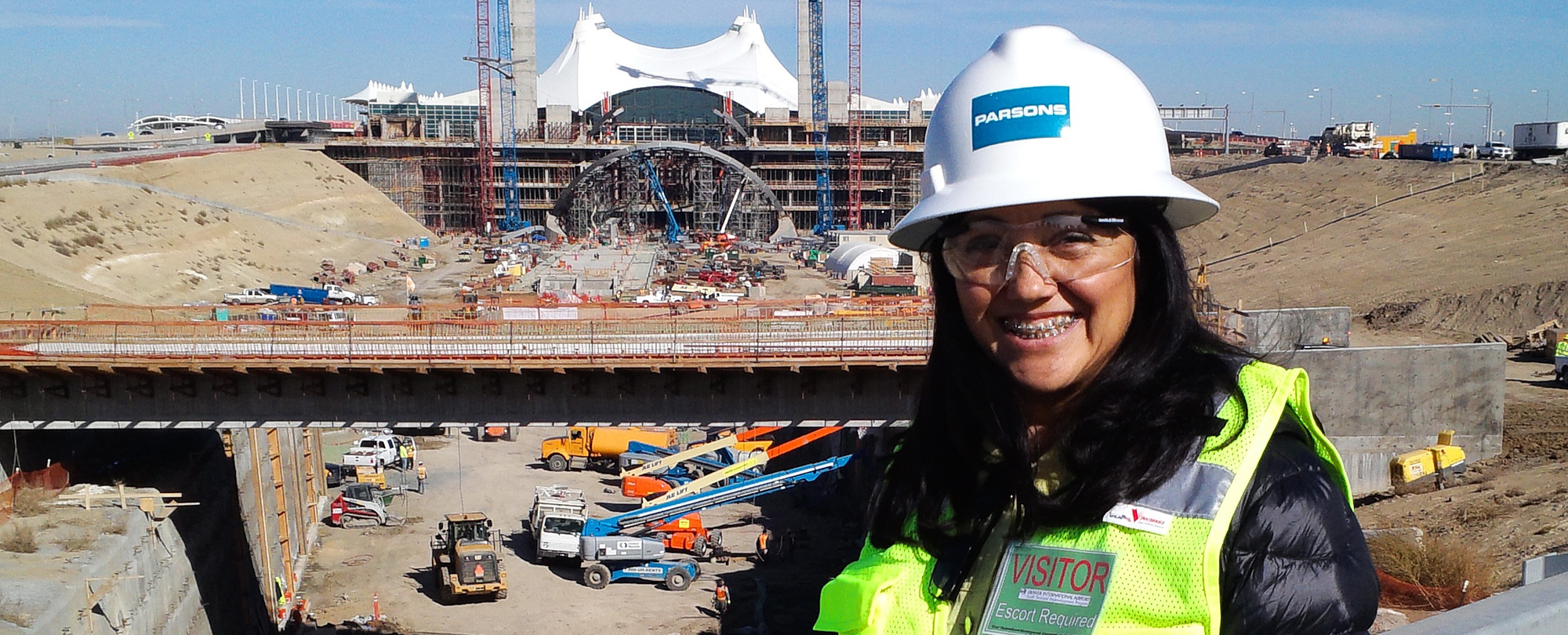 Photo of Councilwoman Debbie Ortega in a hard hat at the DIA hotel expansion construction site