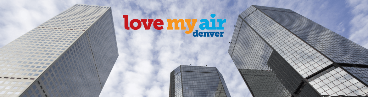 Photo looking up between three Denver downtown commercial buildings and the Love My Air program logo