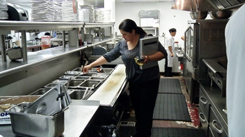 Woman inspecting food facility
