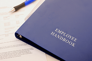 employee handbook on table