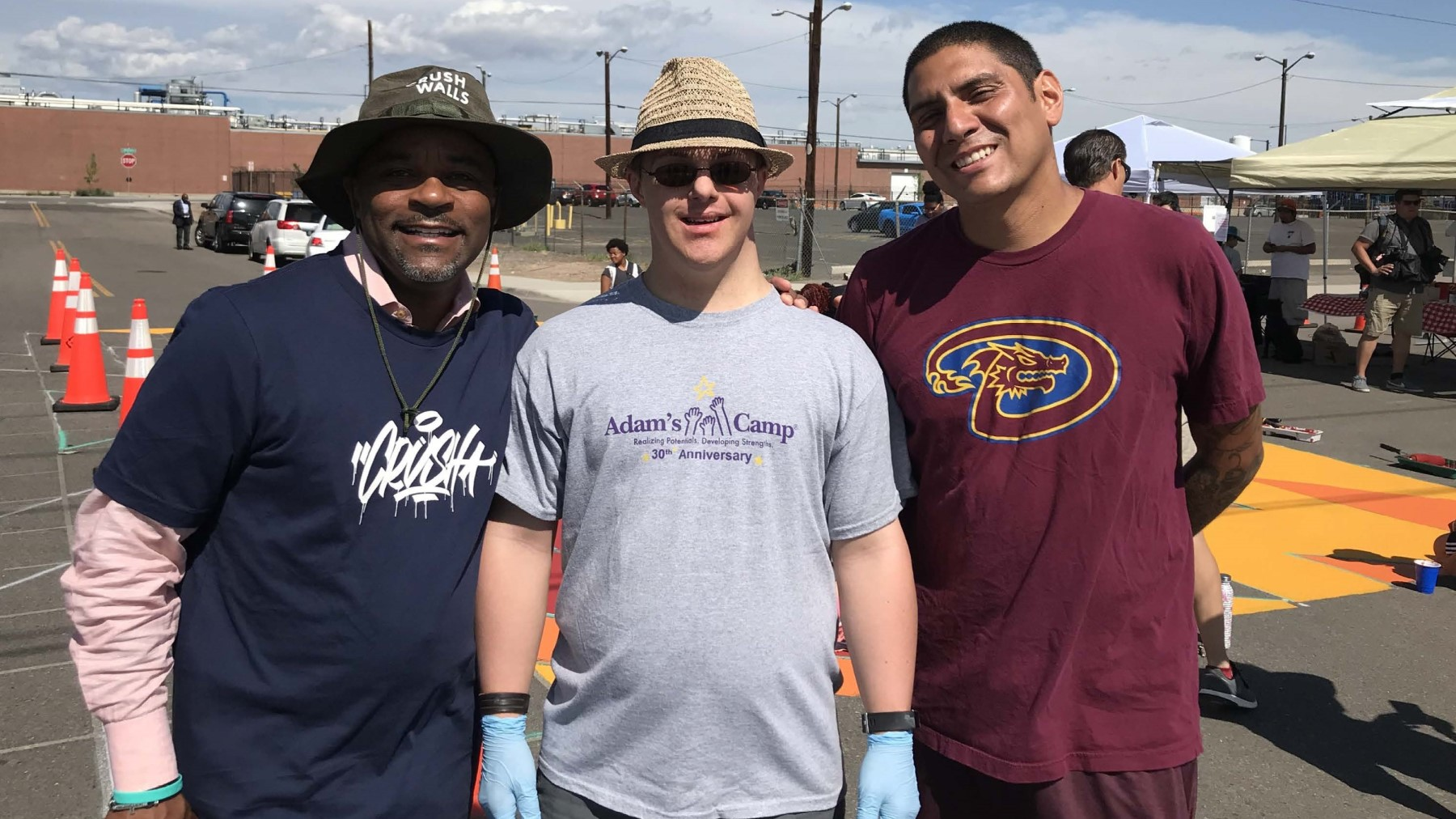 Mayor Michael Hancock poses with local artists that painted an intersection mural at 39th Street and Wynkoop Street