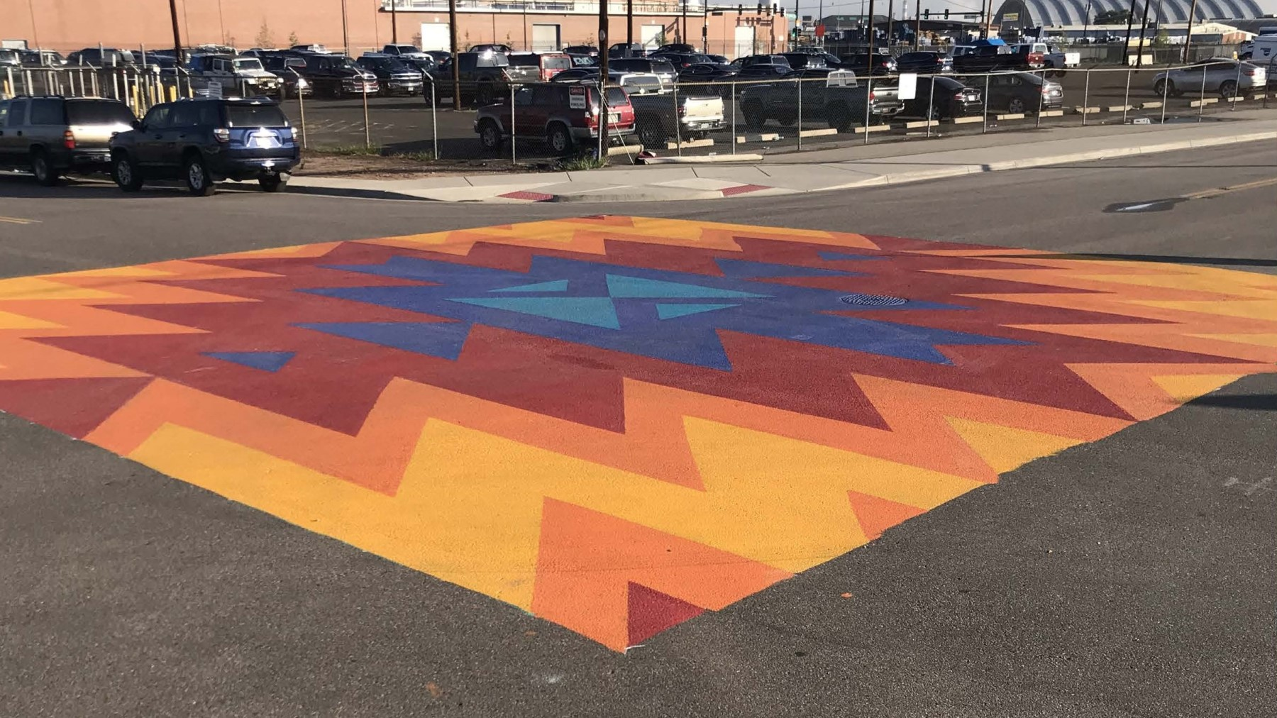 local artists painted an intersection mural at 39th Street and Wynkoop Street
