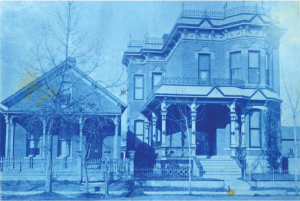 Blue tinted antique photo of a couple of old Denver homes