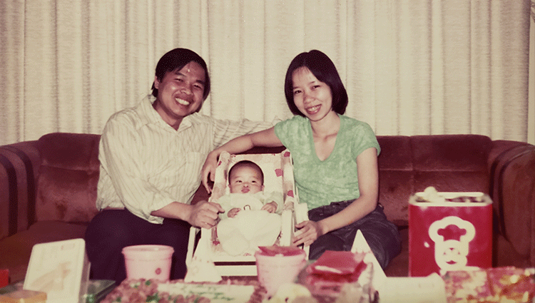 Vietnames couple with baby in living room