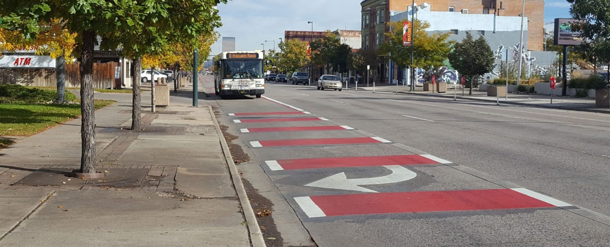 red pavement markings and bus in far right transit lane