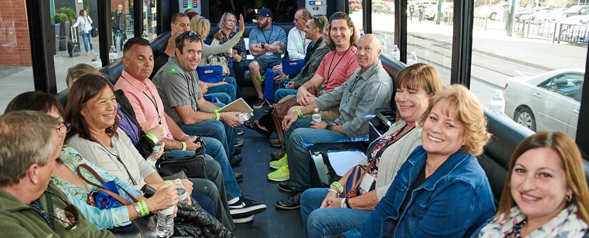 A group of participants sitting on the bus going to the event.