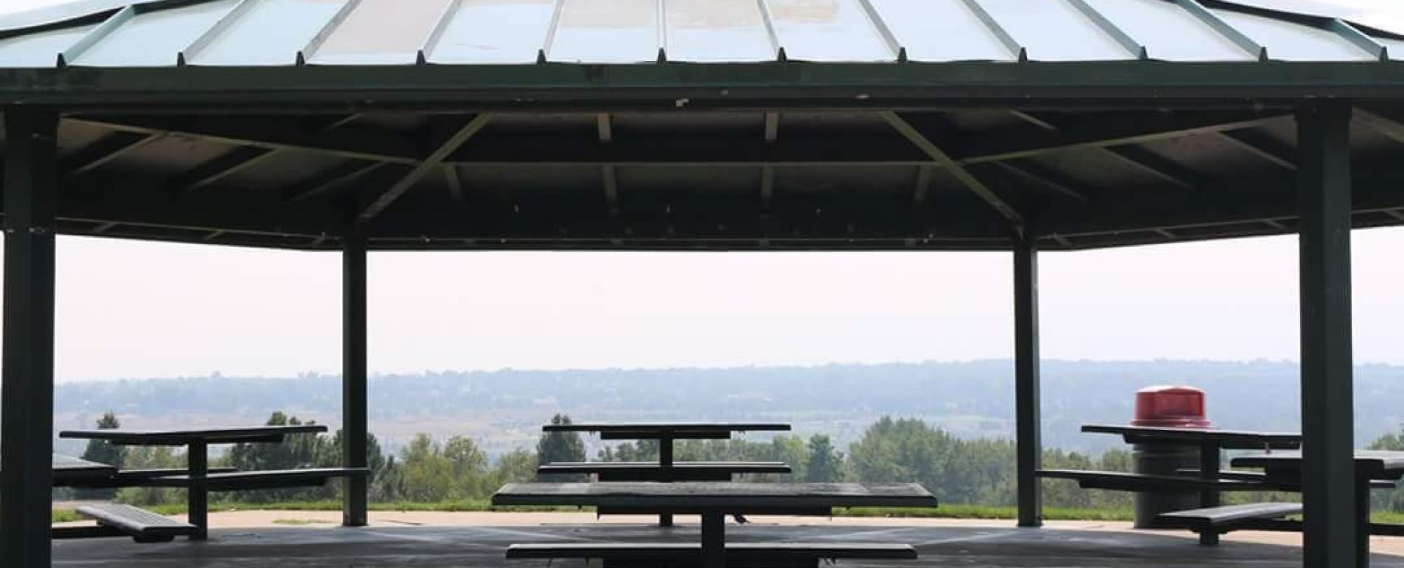 image of a roofed public picnic area