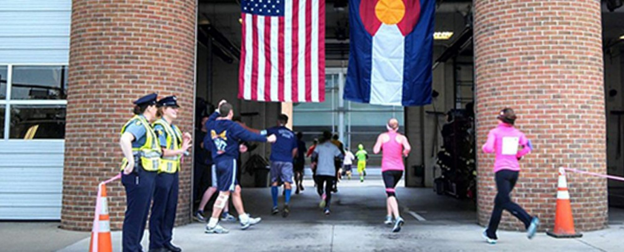 runners jogging into fire station