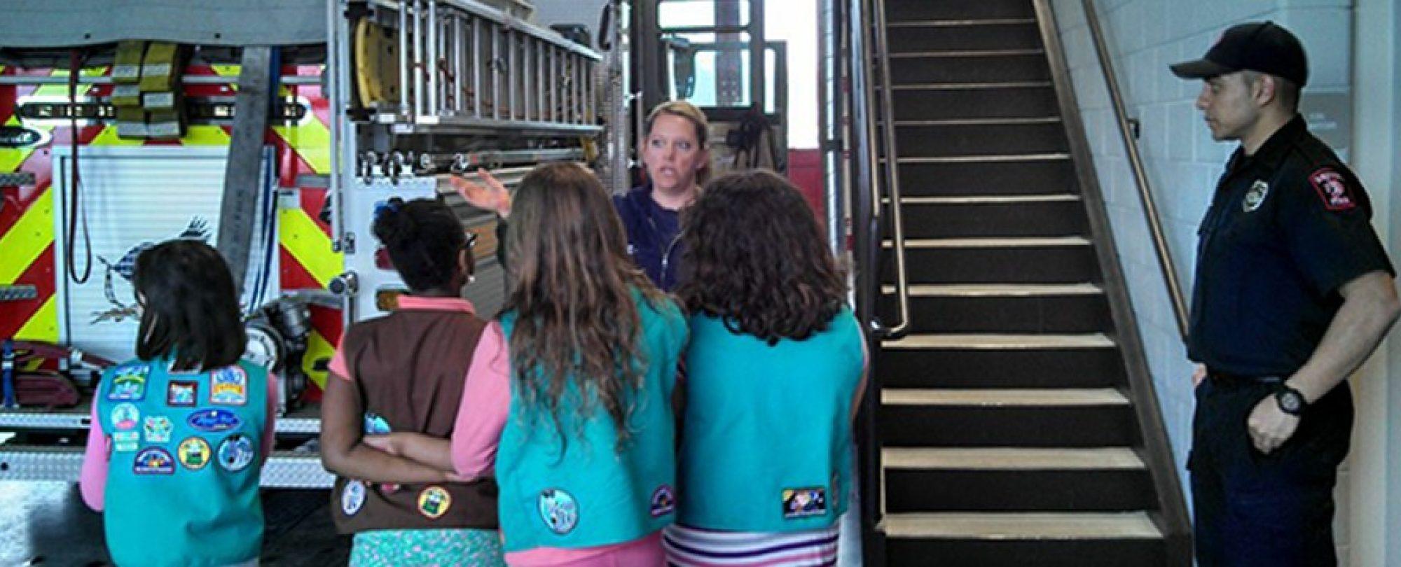 girls scouts touring a fire house