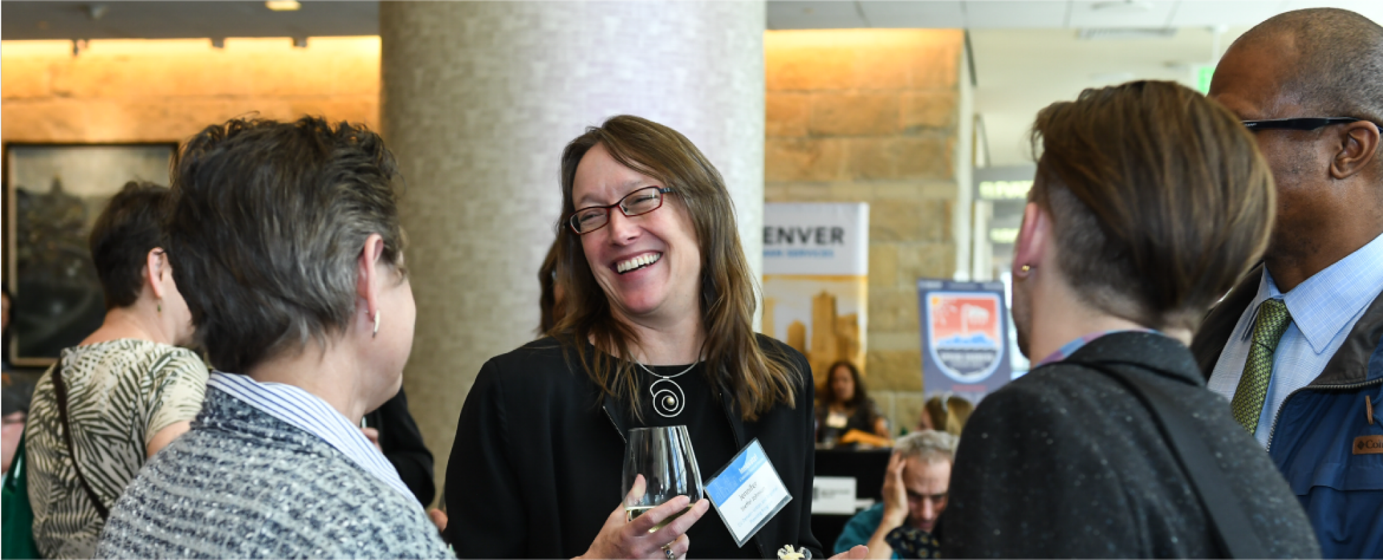 2019 Denver housing Forum Attendees socializing during the social networking event