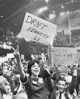 Polly Bacca holds Draft Kennedy 1968 sign