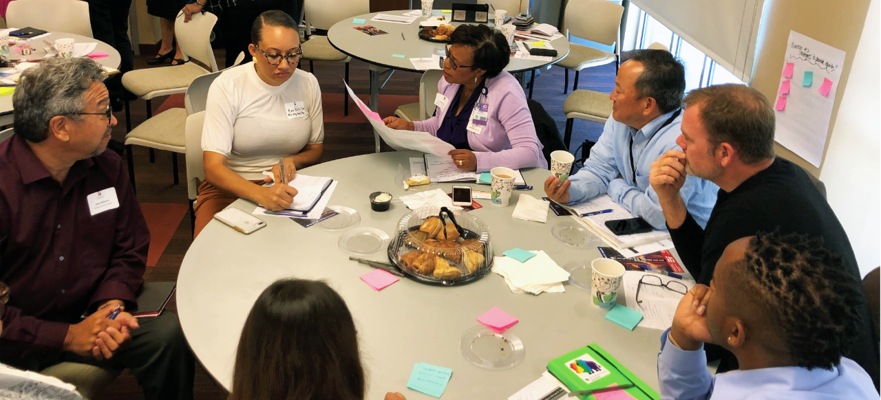 Photo of a group sitting around a table during Social Equity Working Session
