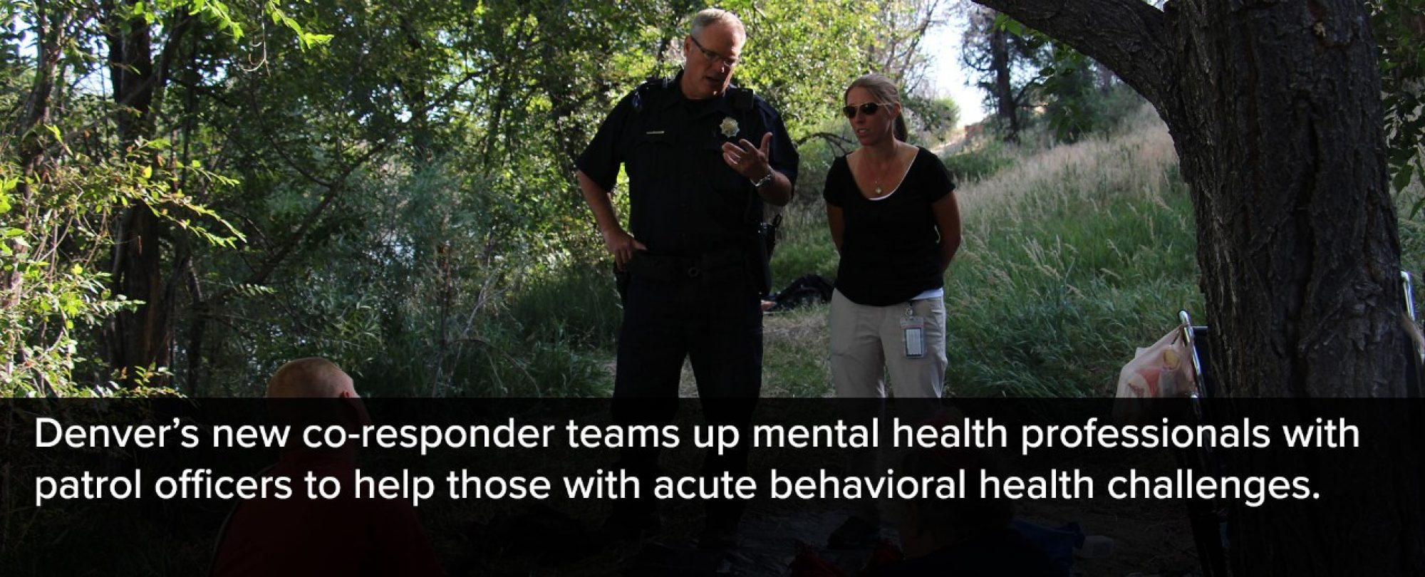 Photo of new co-responders on a park site. Denver's new co-responder teams up mental health professionals with police officers to help those with acute behavioral health challenges.